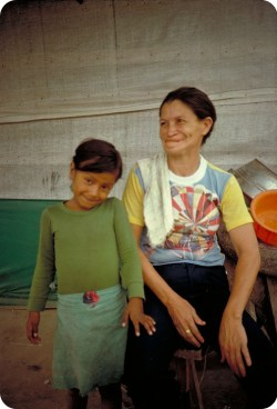 Mercedes Méndez and a child smile in the Mesa Grande refugee camp in Honduras in 1982, following her recovery. (Photo courtesy Philippe Bourgois.)