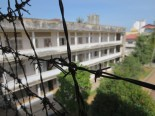 The site has been left almost completely untouched. The barbed wire was put in place to keep prisoners from throwing themselves off the balconies.