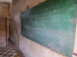 """The fact that S-21 was formerly a school is especially perverse. Here's a surviving chalkboard, on which someone appears to have written rules for student conduct in French. (""""Il est absolument interdit de faire du bruit."""")"""