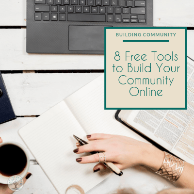 """A women working at a table with pen in her right hand posed to write and a coffee mug in her left hand. In front of her is her laptop and to her right is an open book. Text overlay reads """"Building Community 8 Free tools to build your online community"""""""