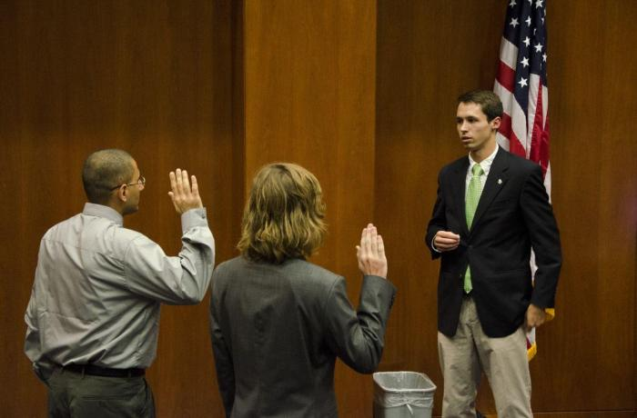 Photo by Connor Spielmaker  UNF Student Body Chief Justice Alex Goetz swears in Gurgen Petrosan and Ross Keen to general Senate seats Sept 24.