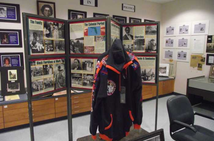 Inside the Durkeeville Historical Center, photos and other historical artifacts are displayed.  Photo by Zach Sweat