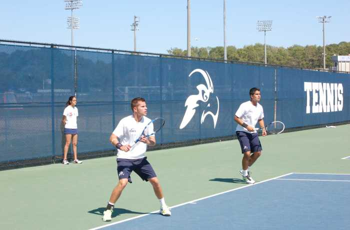 Photo Credit: Travis Gibson Sophomore Norbert Nemcsek (left) and Senior Daniel Sotomarino, pictured in a match against Mercer, are from Hungary and Peru, respectively.