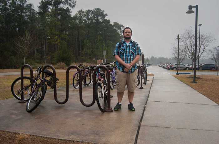 Matthew Adkins a business administration major stands where his bike was once stolen at UNF Fountains. Photo by Randy Rataj.