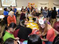 Honors students host an event for local refugees to help them learn about American traditions like Thanksgiving. Each year the Honors Program works with refugees in numerous ways as part of a semester-long service project.  Photo courtesy Dr. Leslie Kaplan, Honors Program