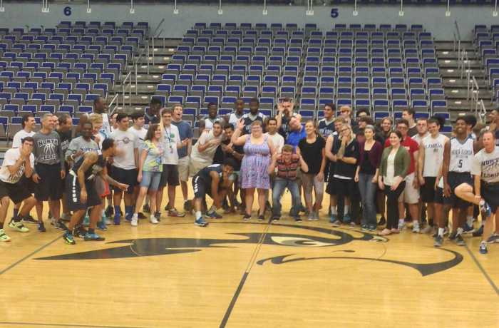 UNF Thrive members, UNF Men's basketball team and members of ATO pose for a group photo. Photo taken by Jordan Bebout