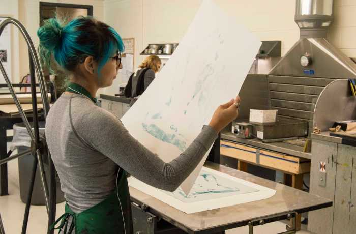 Brittany Gorelick works on a printmaking project in the Fine Arts Building. Printmaking classes are offered through the Art and Design Department.   Photo by Cassidy Alexander