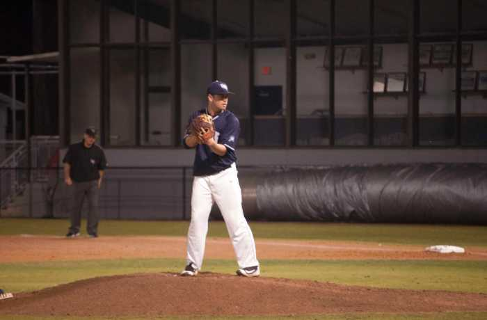 Austin Howze gets set to deliver a pitch against Savannah State.  Photo by Will Weber