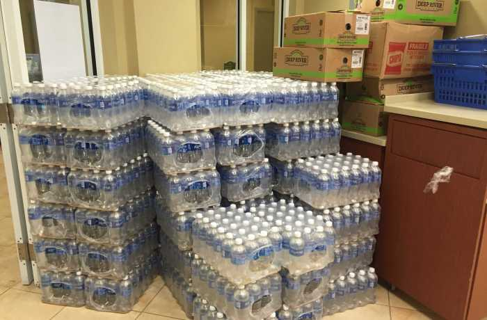 Supplies are piled up outside of Ozzie's in preparation for all UNF residents to evacuate to the Fountains. Photo by Nick Blank