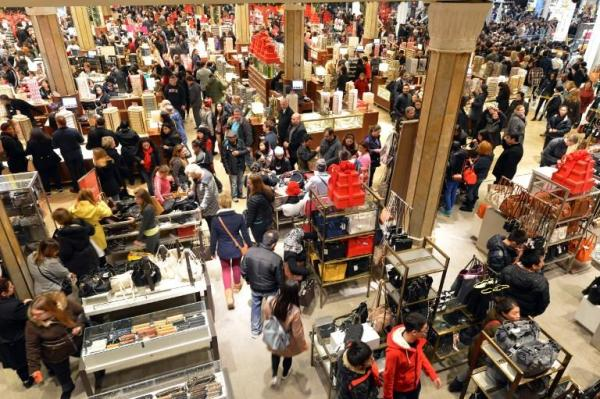 An easy way to avoid crowds like this on Black Friday is to take advantage of deals online. Photo courtesy Stan Honda/AFP Photo