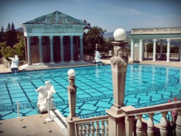 """The present version of the pool was under construction from 1934-1936. It is unlikely that the enlargement was done to make it closer to Olympic size, as has sometimes been conjectured; Olympic pools are 165 feet long. It is more likely that the colonnades and Cassou statues, which were planned from the late 1920′s, required an enlarged treatment. Morgan anticipated further modifications of the pool for Cassou's Neptune statuary group to be placed in the small upper pool. On July 27, 1936, Morgan wrote in a letter to Charles Cassou, """"enclosed is a plan and some photographs of the 'Neptune Pool' in its present (uncompleted) state. The recess of the main pool and the small pool above to receive your 'Neptune' group I have not touched since my visit with you last year – so please do not think of them except as something yet to be done to form a proper background and sitting for your 'Venus' as well as your 'Neptune' statuary."""" The """"Neptune"""" sculpture group by Cassou intended for the small upper pool was never installed. (hearstcastle.org)"""
