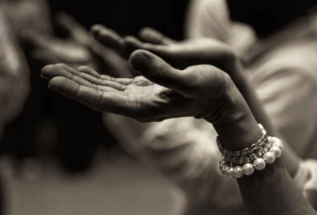 close up of hands turned upward in aspect of praying