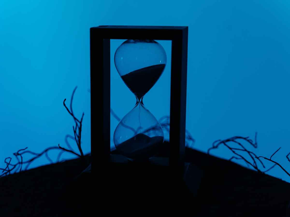 clear hour glass on frame