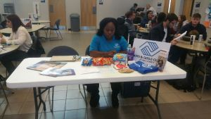 Valerie Frost at her information table offering students opportunities (Photo by Emily Elmore)