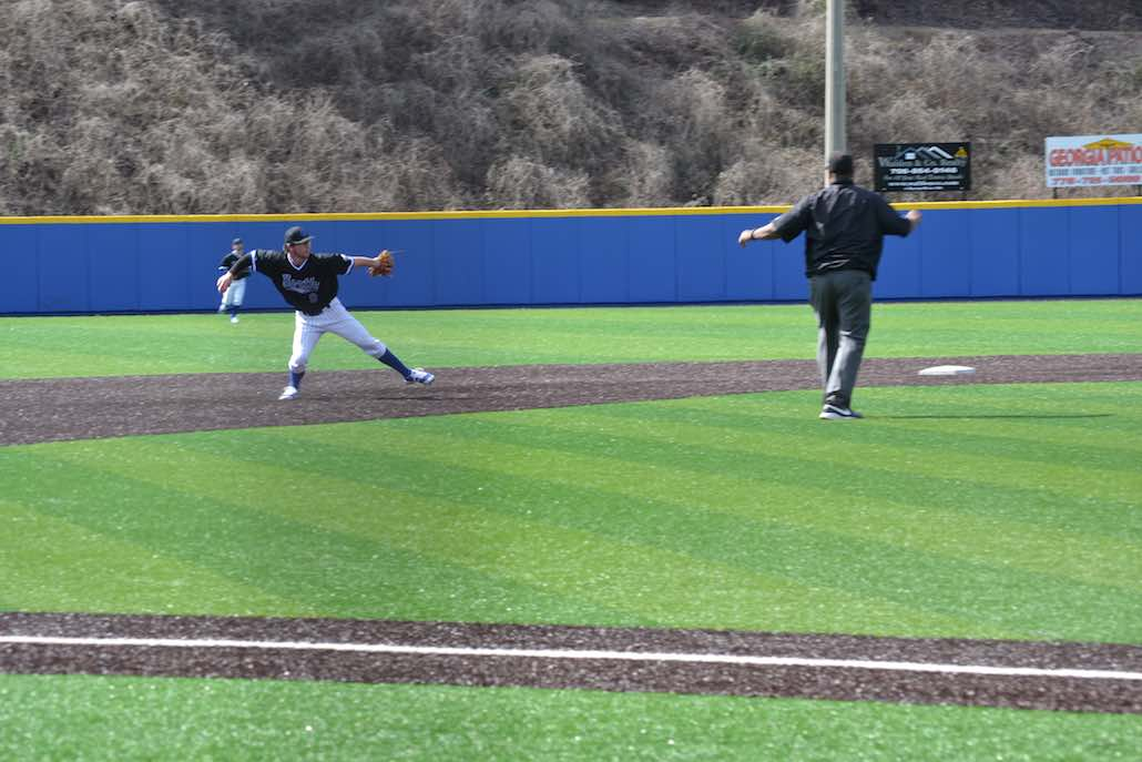 Connor Hoover throws to first during the top of the second inning.