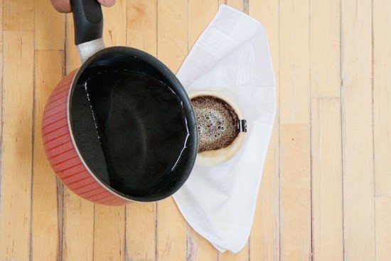 pouring-hot-water-into-coffee-grounds_UNIAREA