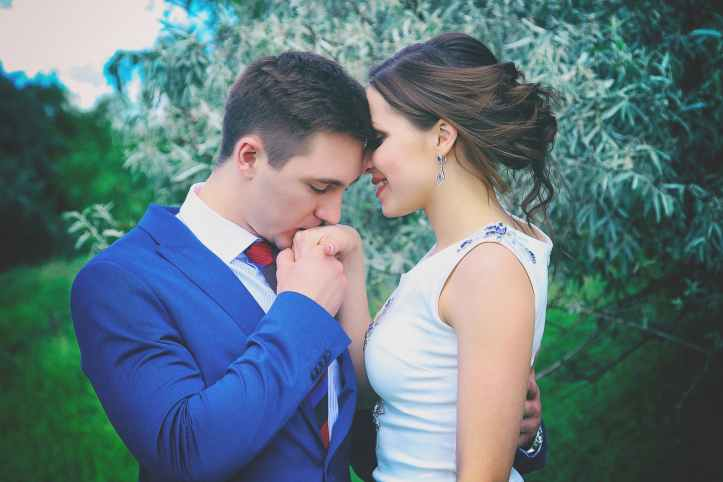 man kissing woman s right hand