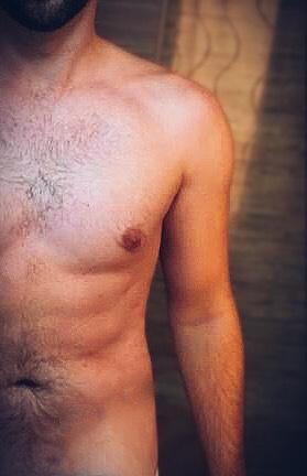 A half profile of a young man's torso