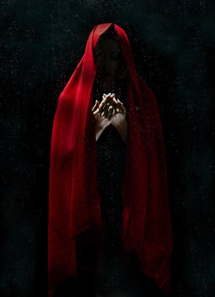 Dark hooded figure