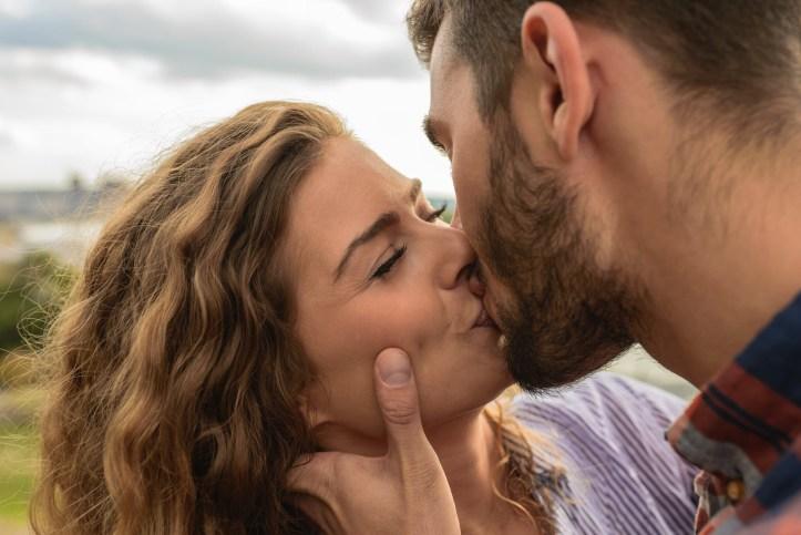 Man and woman kiss