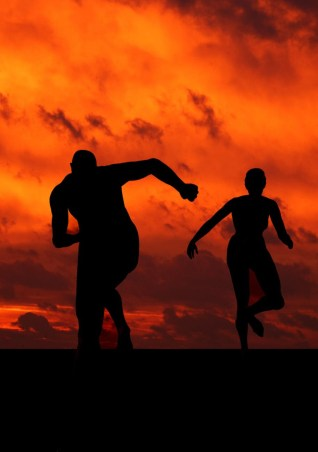 two people running at sunset