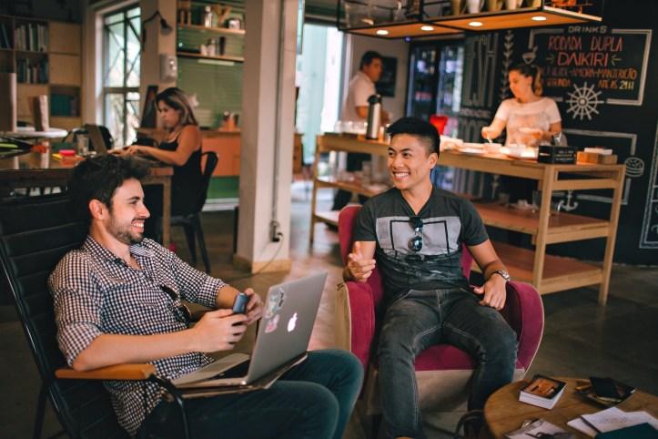 Men talking together in a cafe