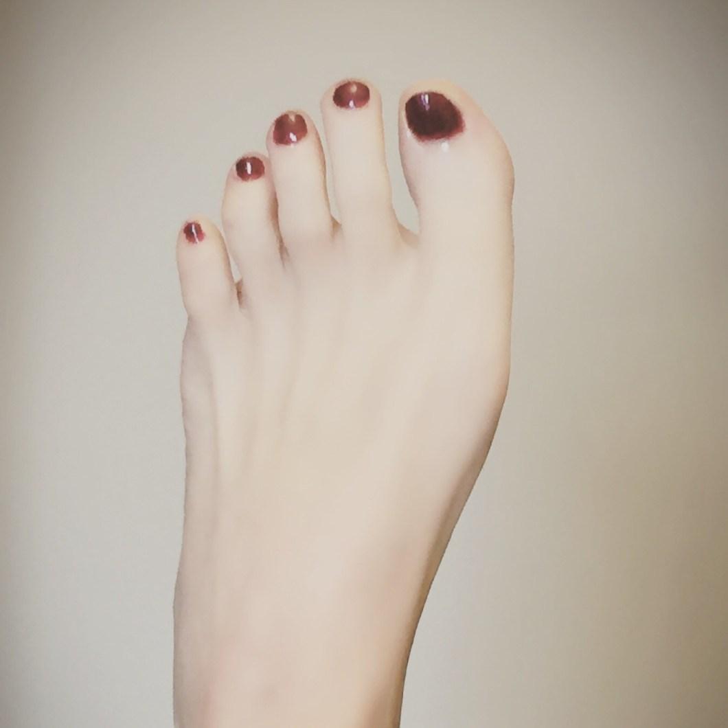 Alice Hunter's red nail polish toenails and foot, ready for Sunday at Rio's Naturist spa