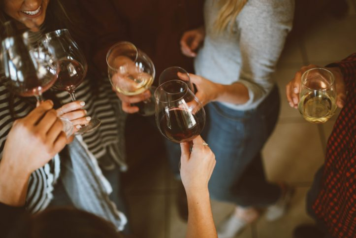 Friends enjoying some wine at a party