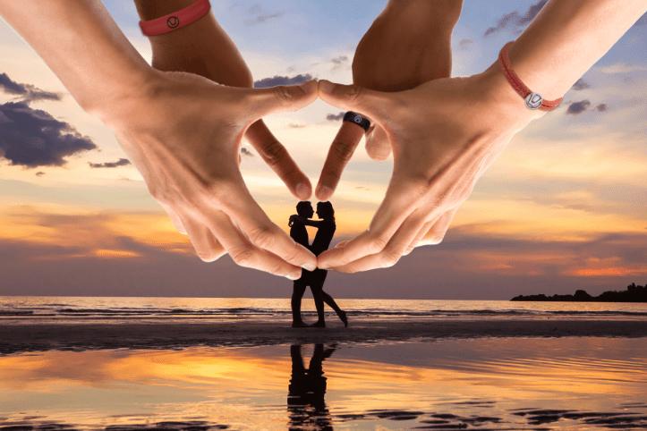 Swinger symbol image of couple on the beach inside hands