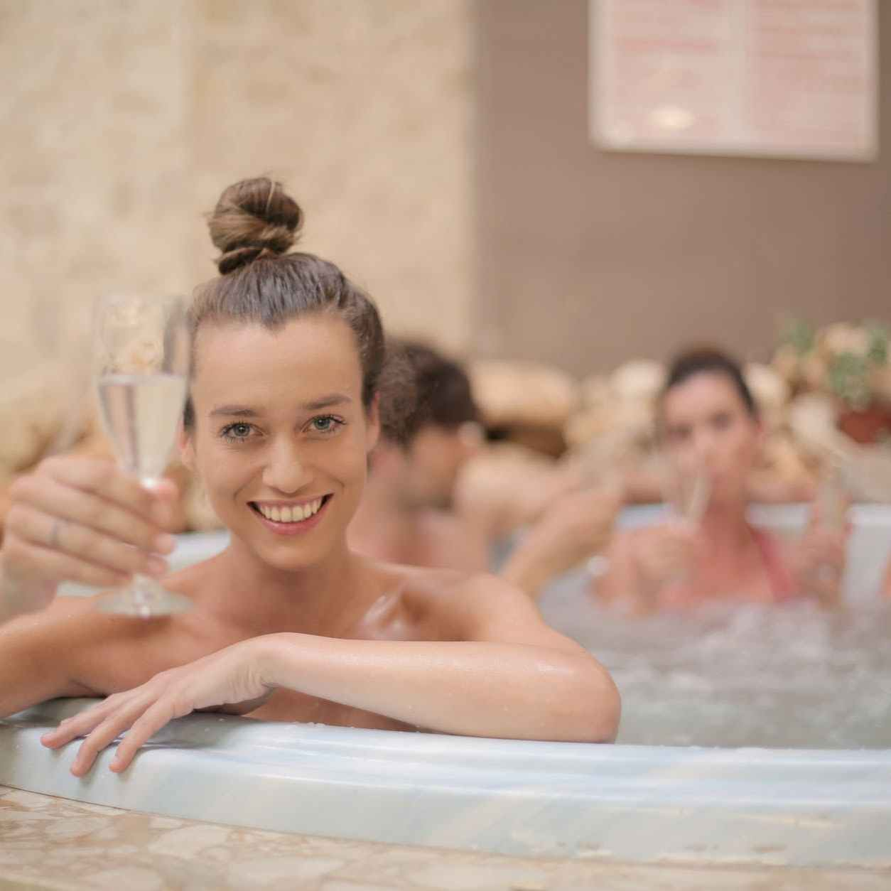 Woman in hottub with champagne glass on categories