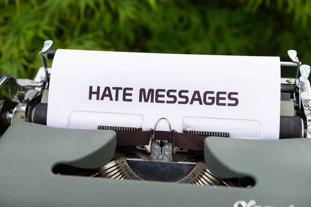 hate messages on old fashioned typewriter