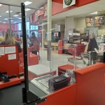 Universal Custom Display UCD PPE Clear Plastic Partition Barriers Setup At Target Cashier Desk Setup Between Cashier And Customer To Keep Customers and Employees Safe From Airborne Viruses