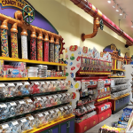 Candy Store Custom Built Display Clear Plastic Containers Holding Chocolate And Gummy Candies