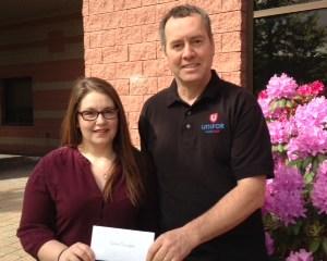 Caitlin Bennett receiving her Scholarship from Committee member Reg Binns
