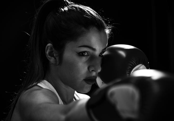 grayscale-photo-of-woman-wearing-boxing-gloves-3817017