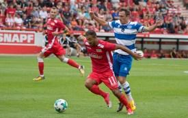 Akaki Gogia pushes through midfield
