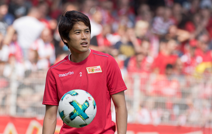 Atsuto Uchida takes in pre-match atmosphere