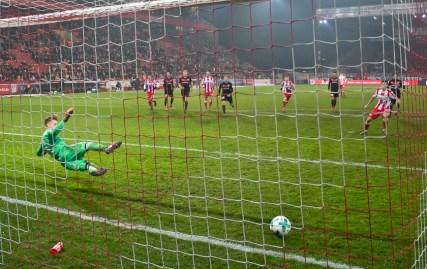 Skrzybski converts a penalty