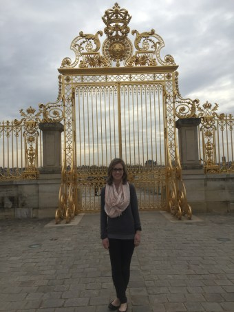 Here I am in front of the golden gate at the Palace of Versailles.