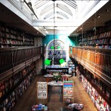 This is a picture of Daunt Books in Marylebone, London. It is a beautiful bookstore that specializes in travel literature. All of the books are organized by continent and country. Although the business changed in the 1990s, there has been a book shop at this site since the 1800s.