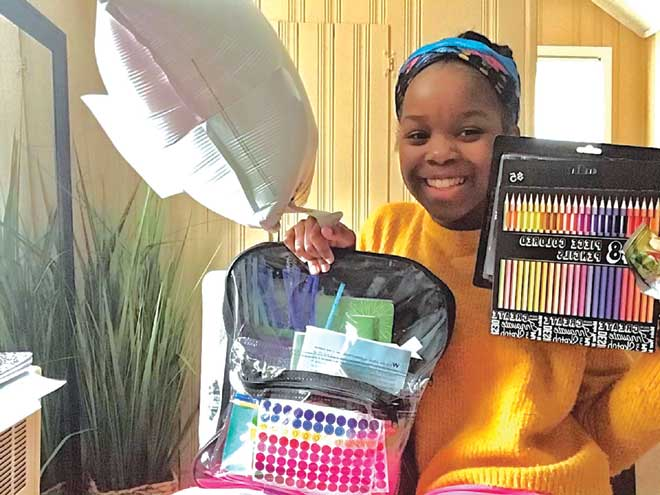 Linden teacher drops off surprise art supplies at students' homes