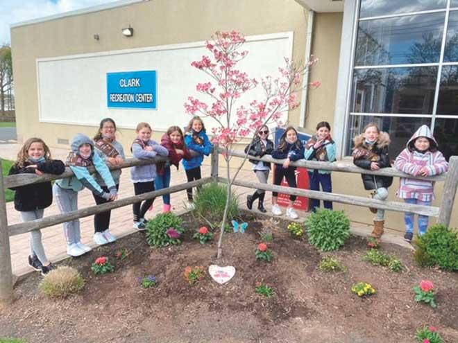 Clark Brownie Troop beautifies recreation center