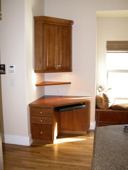 Alder corner desk with keyboard tray. under cabinet LED lighting