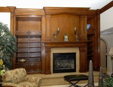Glazed & toned alder cabinetry and mantel with turned columns