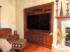 Inset alder wood wide screen TV cabinet. Oil rubbed bronze wire mesh door panels.