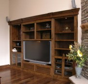 Walnut wall unit for TV; AV units; books & dust collectors.