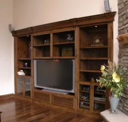Walnut wall unit for TV; AV units; books & dust collectors.