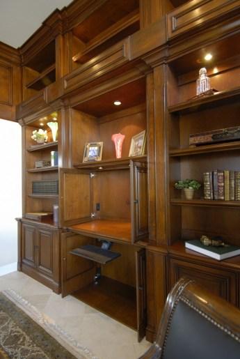 Light walnut finish with glaze. pocket doors for monitor & knee space