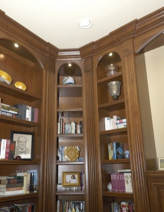 Alder wood multi purpose room. Fluted columns arched top rails. glazed finish.