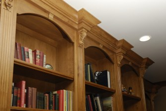 Alder wood office cabinetry with detailed crown